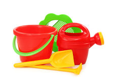 Plastic play set. With bucket, shovel,filter, watering can and rake on white Royalty Free Stock Photos