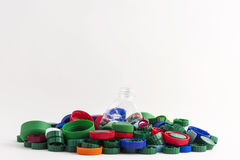 Plastic plugs and bottle Stock Image