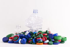 Plastic plugs and three bottles Stock Images