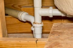 Free Plastic Plumbing Drain Pipe Leaking And Corroded In Bathroom Shower Stock Image - 191721251
