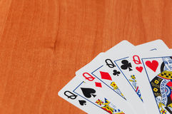Plastic poker cards on wooden background Royalty Free Stock Photography