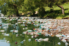 Plastic pollution. Heavy plastic pollution in wild beautiful landscape Royalty Free Stock Photos