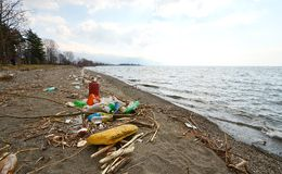Plastic pollution on a beach of Lake Ohrid , Macedonia Royalty Free Stock Photo