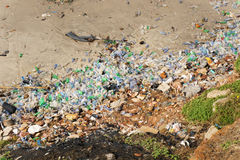 Plastic pollution in the beach Royalty Free Stock Photo