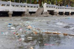 Plastic pollution environmental problem in ocean. Enviromental Pollution in the beach,Plastic bottles and other garbage washes up on beach royalty free stock images