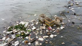 Plastic pollution in water. Plastic pollution in water with Styrofoam products and others stock photography