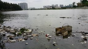 Plastic pollution in water. stock video footage