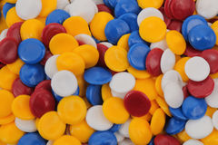 Plastic polymer. Colorful plastic polymer granules on white Stock Images