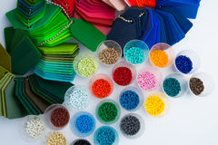 Plastic polymer granulate. Several dyed plastic polymer granulates in laboratory Stock Photo