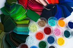 Plastic polymer granulate. Several dyed plastic polymer granulates in laboratory Stock Photos