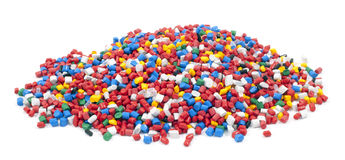 Plastic polymer granules. Colorful plastic polymer granules on white background Royalty Free Stock Photography