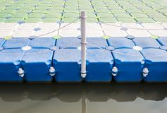 Plastic pontoon with the rope fence. Stock Image