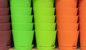 Plastic pots for flowers in bright colors royalty free stock image