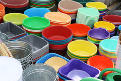 Plastic products on the market. Plastic utensils for household use, showcase in the market Royalty Free Stock Photo