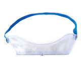 Plastic protective work glasses with ruber band isolated over white background. Stock Image