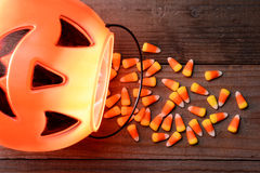 Plastic Pumpkin and Candy Corn Spill royalty free stock photos