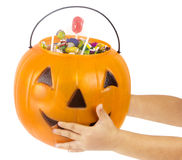 A plastic pumpkin filled with candy Stock Image
