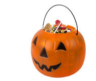 A plastic pumpkin filled with candy isolated Stock Photo