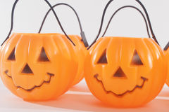 Plastic Pumpkins. With scary happy faces royalty free stock photography