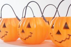 Plastic Pumpkins. With scary happy faces Stock Image
