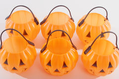 Plastic Pumpkins. Six plastic pumpkins with scary happy faces Royalty Free Stock Images