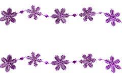 Plastic purple snowflakes Stock Photography