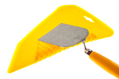 Plastic putty knife and plastering trowel Stock Photography