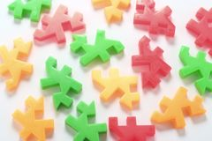 Plastic Puzzles. An arrangement of plastic puzzles royalty free stock images