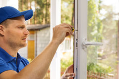 Plastic window installation and maintenance service. Plastic pvc window installation and maintenance service Royalty Free Stock Photography