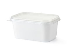 Plastic rectangular container for dairy foods. Standing on a white Royalty Free Stock Photos