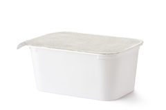 Plastic rectangular container with foil lid. Laying on a white Stock Photo