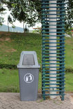 Plastic recycle bin. Gray plastic recycle bin in the park Stock Photos