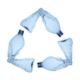 Plastic recycling. Three blue plastic bottles forming the symbol of recycling Royalty Free Stock Photos