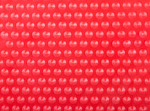 Plastic Red Background with Many Cone Round Dots Royalty Free Stock Photo