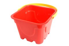 Plastic red bucket toy. Isolated on the white background Royalty Free Stock Photo
