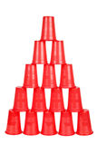 Plastic red cups pyramid Royalty Free Stock Photos