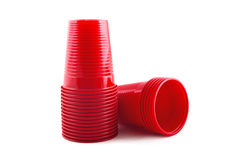 Plastic red cups stack on white background Royalty Free Stock Images