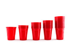 Plastic red cups stack on white background Stock Image