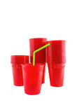 Plastic red cups on white background Royalty Free Stock Images