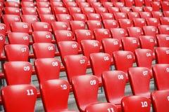 plastic red placerar stadion Royaltyfri Bild