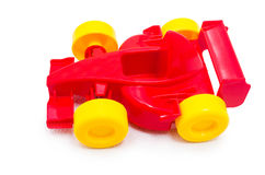 Plastic red racing toy car toy with yellow wheels. On white background Stock Images