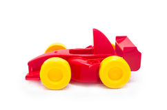 Plastic red racing toy car toy with yellow wheels Stock Images