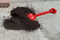 Plastic red shovel with black ground Stock Image