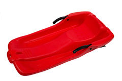 Plastic red sled for skiing on white background Stock Photo