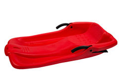 Plastic red sled for skiing on white background Royalty Free Stock Photo