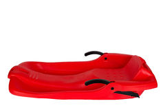 Plastic red sled for skiing on white background Royalty Free Stock Photography