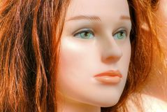Plastic Redhead Girl. Conceptual image, beautiful Plastic Redhead Girl royalty free stock images