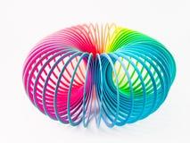 Plastic regenboogstuk speelgoed Stock Foto