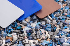 Plastic regrind with samples Royalty Free Stock Photography