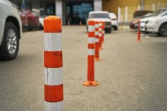 Plastic restricting bollards on the parking area near supermarket. In Moscow Royalty Free Stock Images